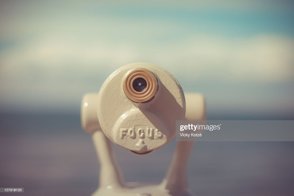 Tourist binoculars looking out to sea