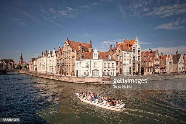 Tourist boat on the Spinolarei canal, Bruges