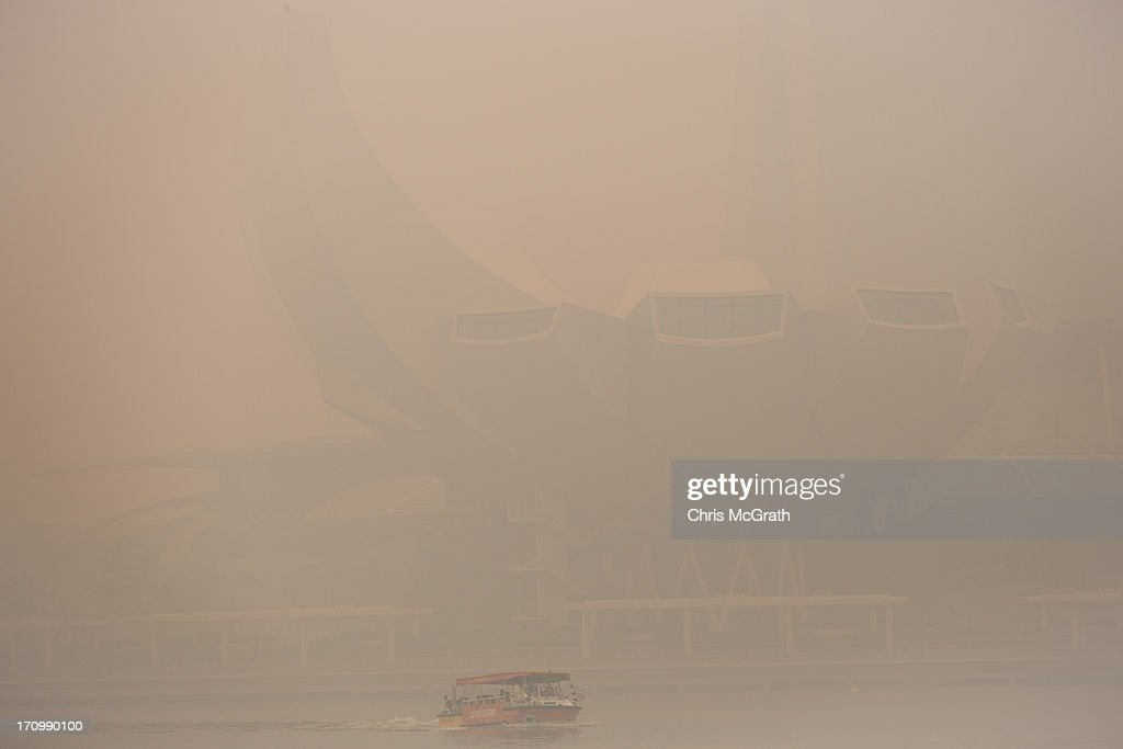 A tourist boat passes in front of the Singapore Art Science Museum which is barely visible as it is covered in thick smoke haze on June 21, 2013 in Singapore. The Pollutant Standards Index (PSI) rose to the highest level on record reaching 400 at 11am. The haze is created by deliberate slash-and-burn forest fires started by companies in neighbouring Sumatra.