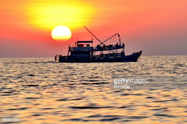 Tourist boat with Sunset at Samed Island