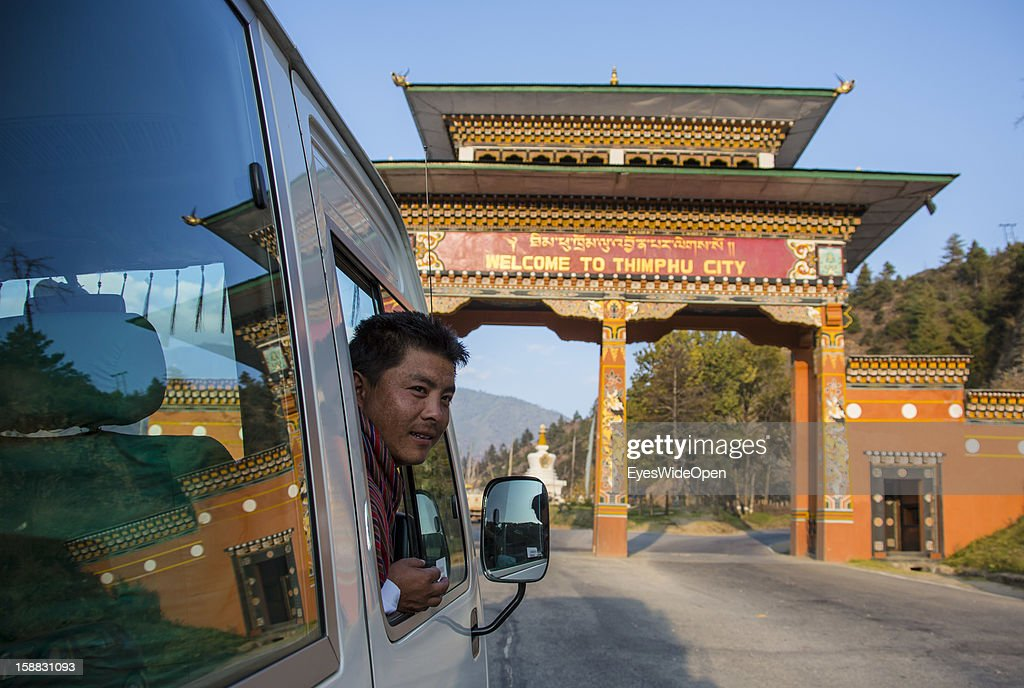A tourist bus driver at the entrance gate to Thimphu, the capital of Bhutan on November 18, 2012 in Thimphu, Bhutan.