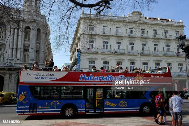 A tourist bus drives past the Inglaterra Hotel in Havana on January 26 2017 Cuba is in style since there was an approach in its relationship with the...