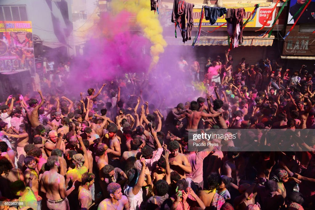 Tourist celebrate the Holi cloth tearing (Kapda Phad), the Holi celebration in Pushkar, India.