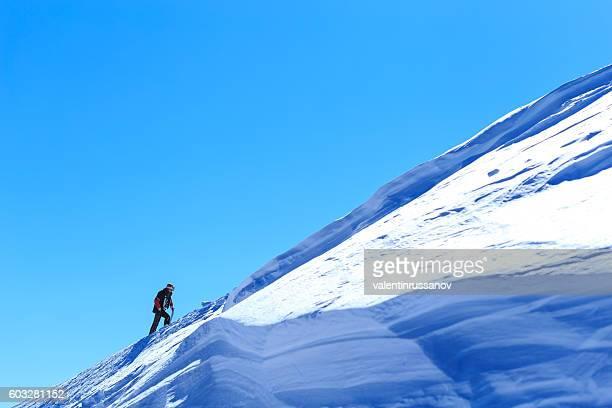 Tourist climbing up in Bansko ski resort, Bulgaria
