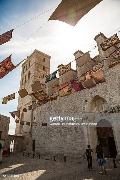 Tourist couple at castle in Old Town Ibiza, Spain
