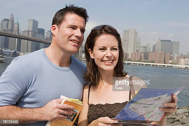 Tourist Couple Consulting Map