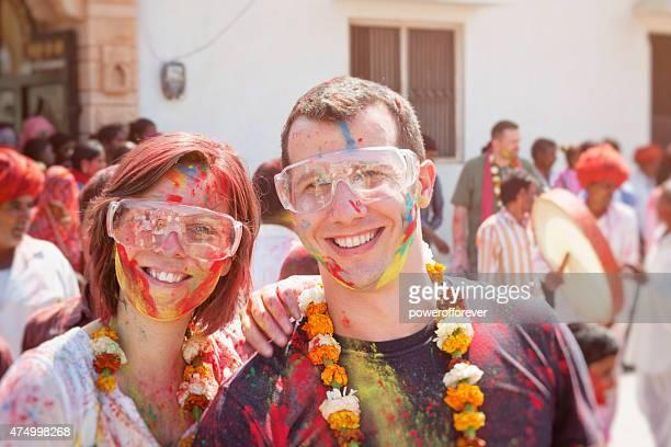 Tourist Couple Enjoying Holi Festival in Rural Indian Village