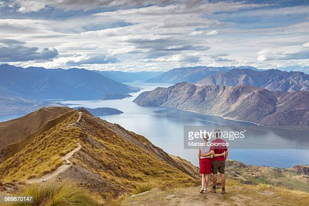Tourist couple looking at  scenic landscape