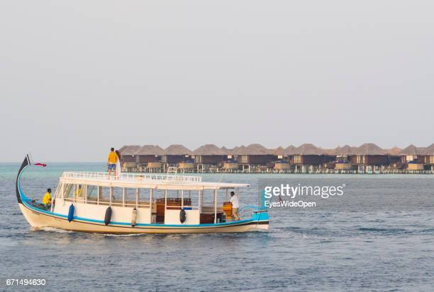 Tourist Couple on a Romantic Sunset Cruise at the Beach at Coco Bodu Hiti NorthMaleAtoll on February 24 2017 in Male Maldives