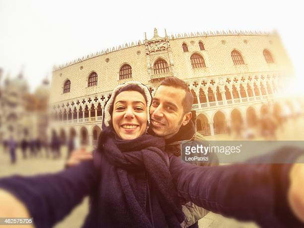 Tourist couple selfie in Doges Palace, Venice