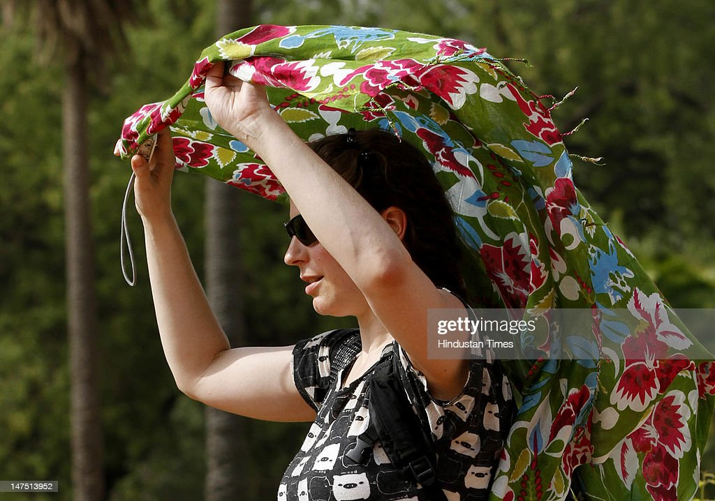 A tourist covering her head with a dupatta at the Hamuyun Tomb as temperature soar on July 1, 2012 in New Delhi, India. The entire North India and other parts of India reeling under hot wave condition and recording the highest temperature of the season these days.