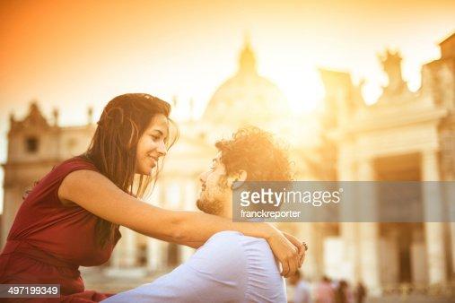 Tourist embracing at sunset