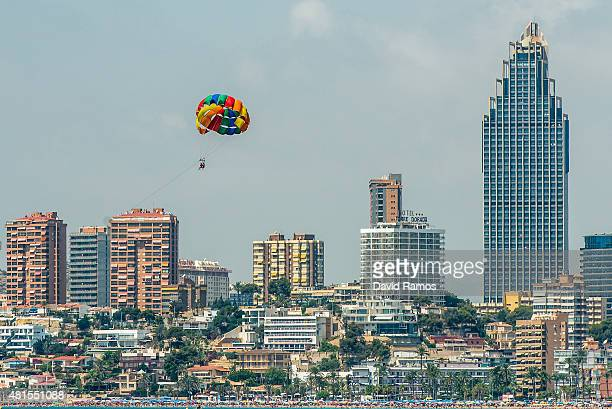 A tourist enjoy parasailing at Poniente Beach on July 22 2015 in Benidorm Spain Spain has set a new record for visitors with 292 million visitors in...