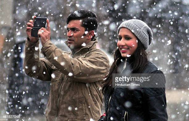 Tourist enjoying snowfall at the ridge on January 14 2015 in Shimla India Shimla and its surrounding resorts of Kufri Fagu and Narkanda had another...