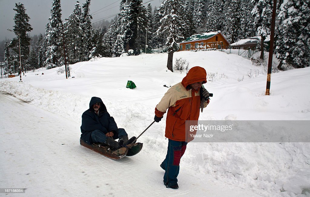 A tourist enjoys a toboggan ride during the season's first snowfall, on November 29, 2012 in Gulmarg, 54 km (35 miles) to the west of Srinagar, the summer capital of Indian-administered Kashmir, India. As the Kashmir valley received heavy snowfall in its upper reaches, the 434-km Srinagar-Leh National highway, the highest motorable road in the world, was closed to traffic. The famous ski resort of Gulmarg also experienced the first heavy snowfall of the season, officials said. Gulmarg, located less than six miles from the ceasefire line or Line of Control (LoC) that divides Kashmir between India and Pakistan, is known for long-run skiing, snow-boarding, heli-skiing and steep mountains.