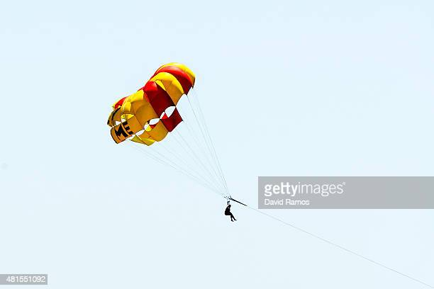 A tourist enjoys parasailing at Poniente Beach on July 22 2015 in Benidorm Spain Spain has set a new record for visitors with 292 million visitors in...