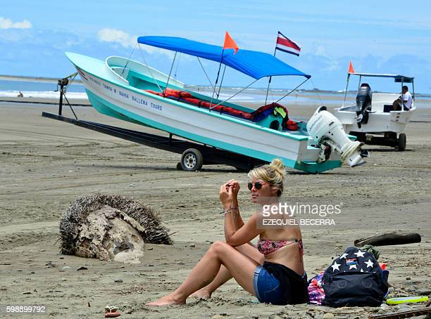 A tourist enjoys the day at Bahia Ballena Beach in Puntarenas about 230 km southwest of San Jose during the 8th Annual Whale and Dolphin Festival on...