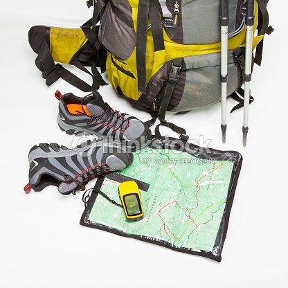 Tourist equipment  backpack  shoes  map  gps on white background   Stock  Photo 9065c746e2772