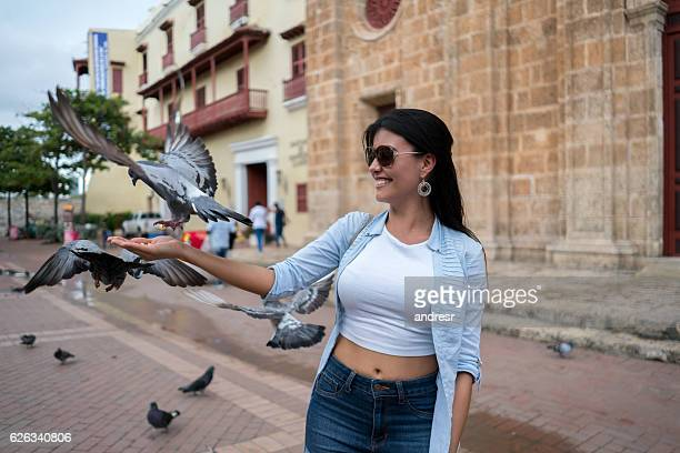 Tourist feeding doves in Cartagena