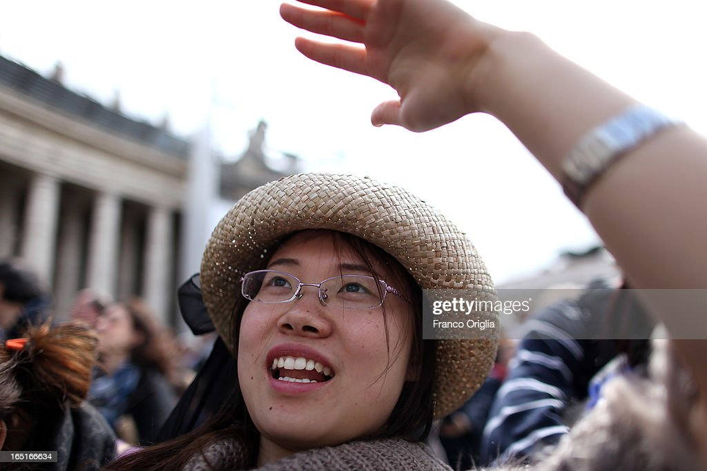 A tourist from China gather attends the Regina Coeli Prayer in St. Peter's Square held by Pope Francis on April 1, 2013 in Vatican City, Vatican.