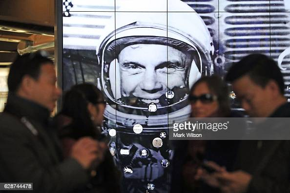 Tourist gather near a tribute to former Astronaut and US Senator John Glenn at the National Air and Space Museum December 9 2016 in Washington DC...