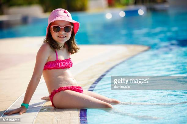 Tourist girl at the swimming pool