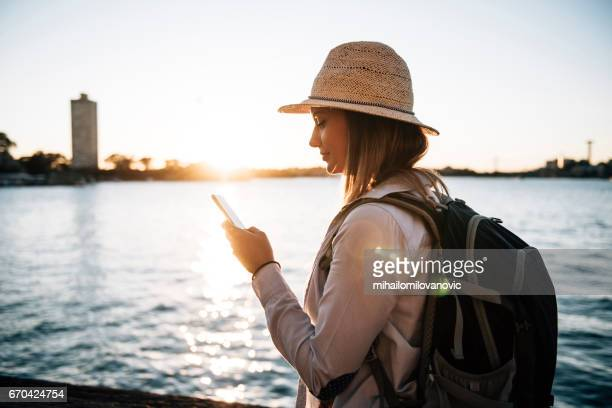 Tourist girl using her mobile phone