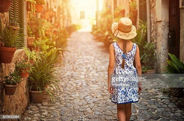 Tourist girl visiting mediterranean town.