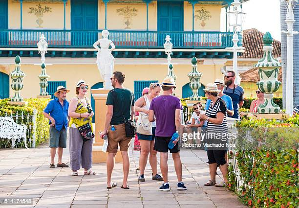 Tourist group gathered in main plaza waiting for the tour to begin Trinidad is a Unesco World Heritage Site and main tourist attraction
