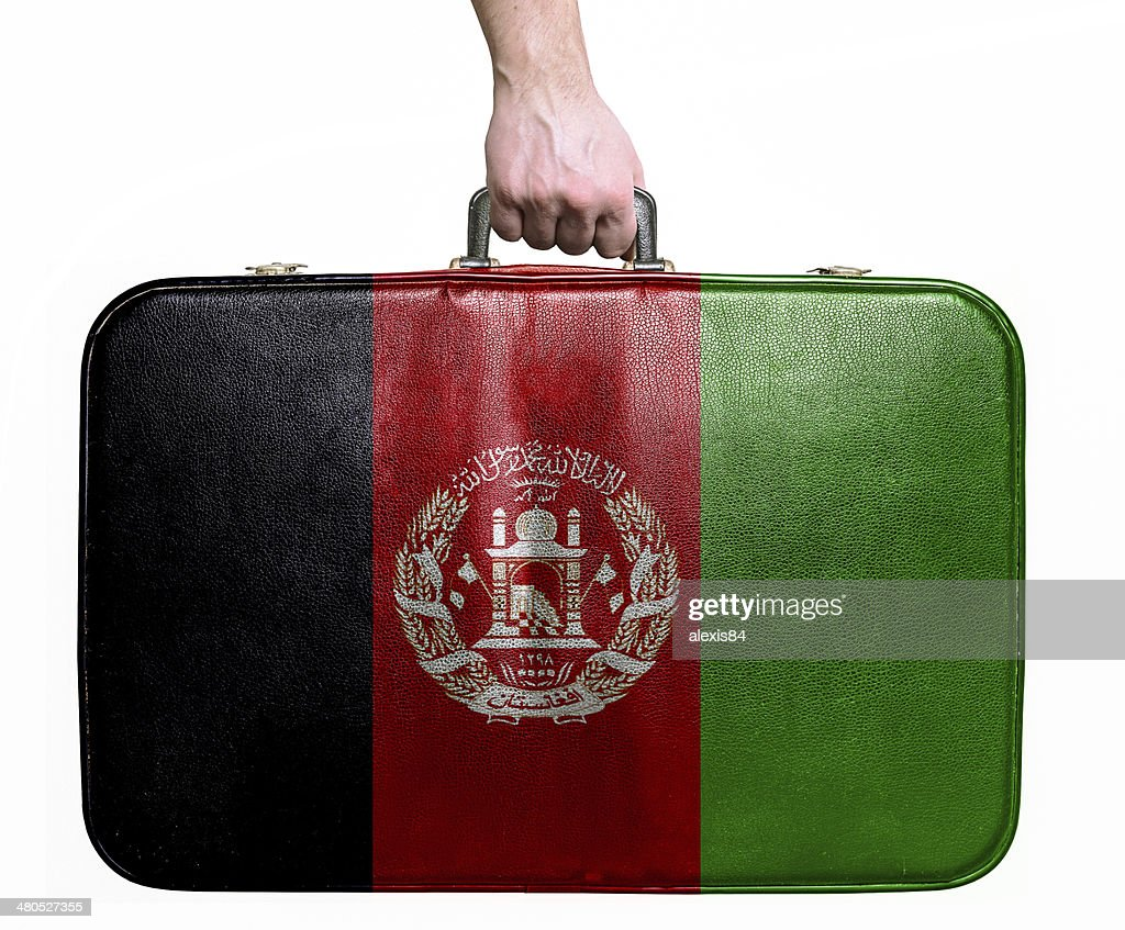 Tourist hand holding vintage travel bag with flag of Afghanistan : Stock Photo