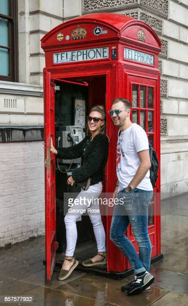 Tourist have fun taking pictures of a red phone booth near Westminster Underground Station on September 13 in London England Great Britain's move...