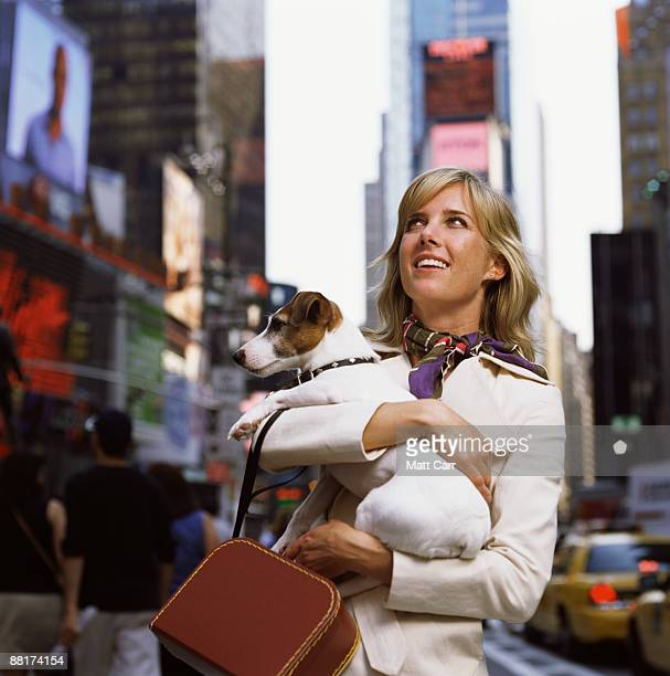 Tourist holding her dog in Time Square,  New York City
