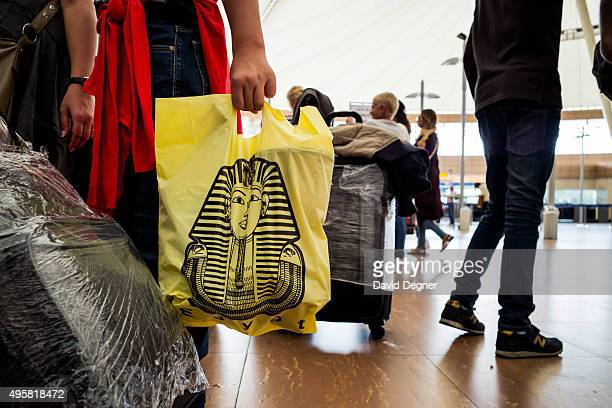 A tourist holds a souvenir bag in the airport on November 5 2015 in Sharm ElSheikh Egypt British flights going to and from Egyptian resort of Sharm...