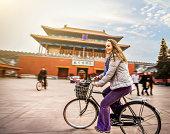Tourist in Beijing riding bike
