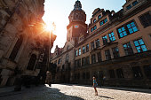 Young lady tourist standing between old buildings in the city of Dresden