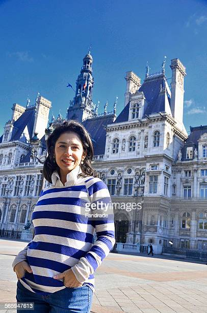 A tourist in front of the Hotel Deville in Paris