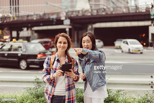 Tourist in Japan asking local people for navigation