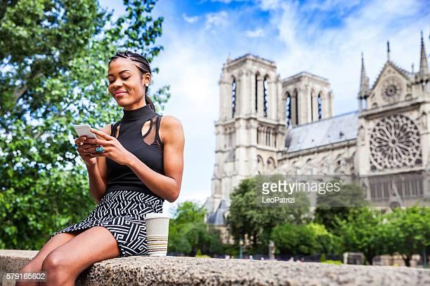 Tourist in Paris, woman having a break in Notre Dame