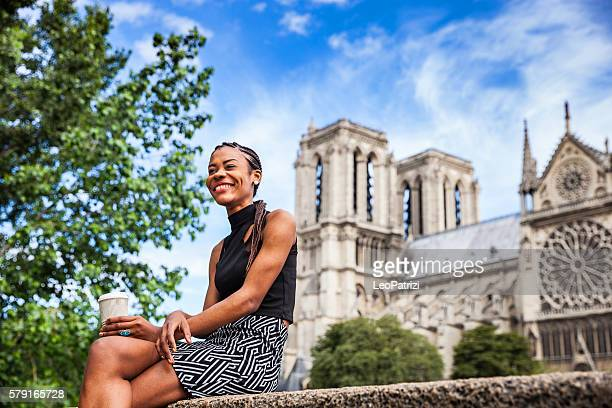 Tourist in Paris, woman having a break in Notre Dame