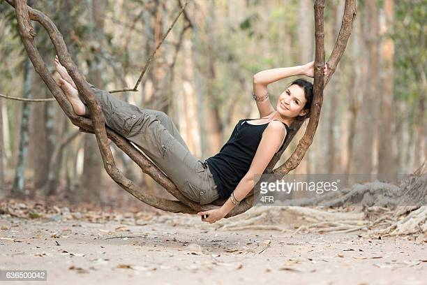 Tourist in the Rain Forest relaxing, Natural Hammock Vine