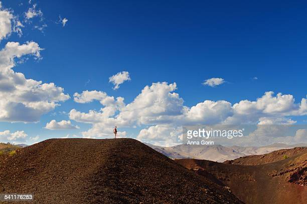 Tourist in volcanic landscape, Craters of the Moon