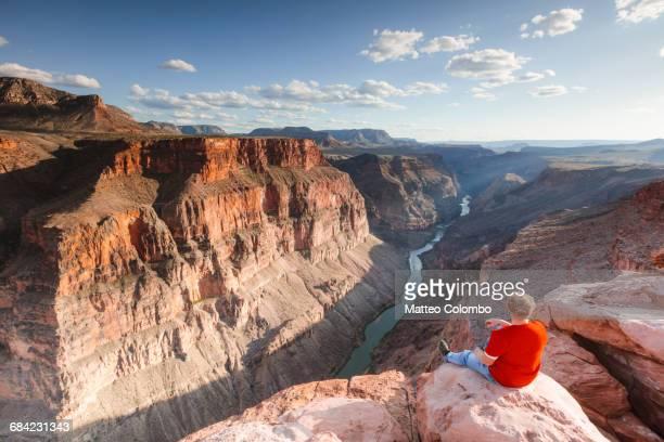 Tourist looking at Colorado river, Grand Canyon