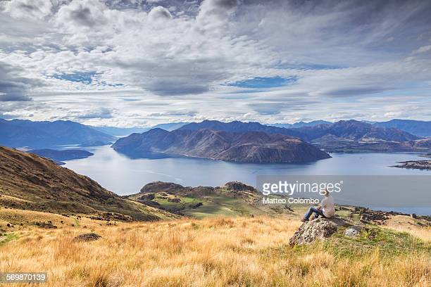 Tourist looking at lake Wanaka from mount Roy