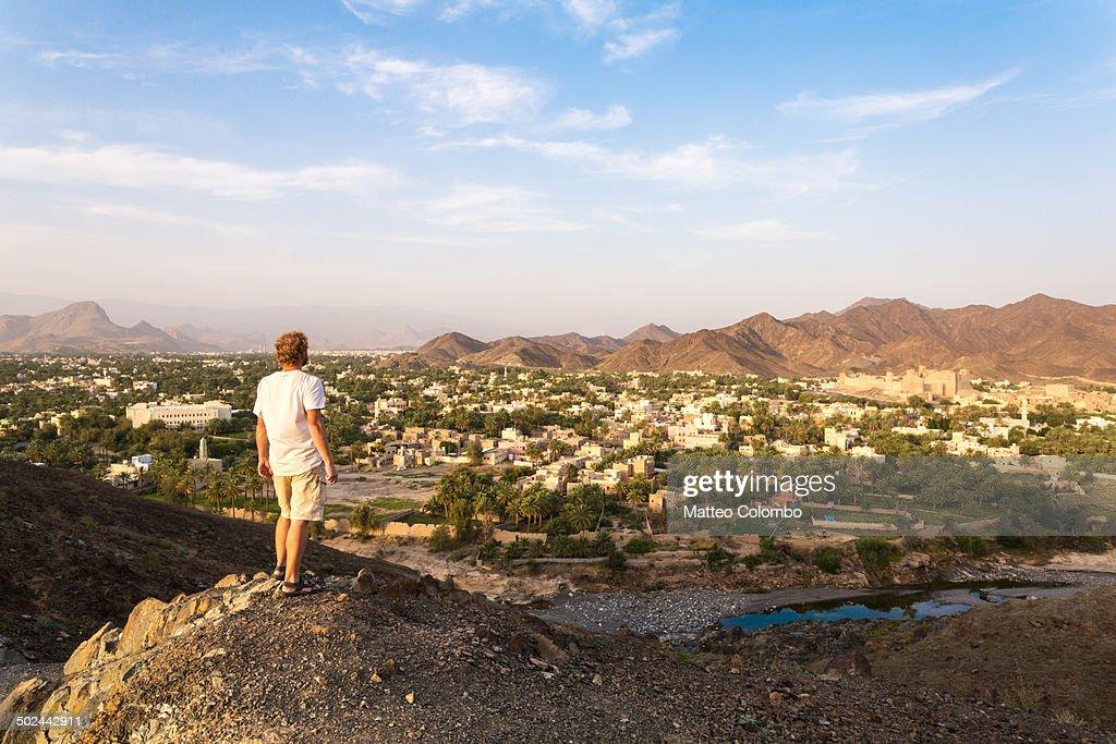Tourist looking at landscape around Bahla