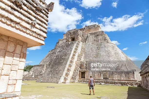 Tourist looking at pyramid , Uxmal, Mexico