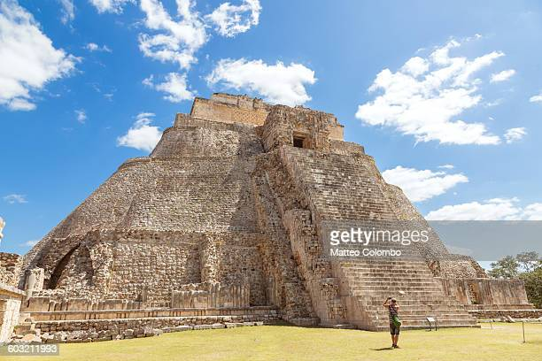 Tourist looking at temple, Uxmal, Mexico