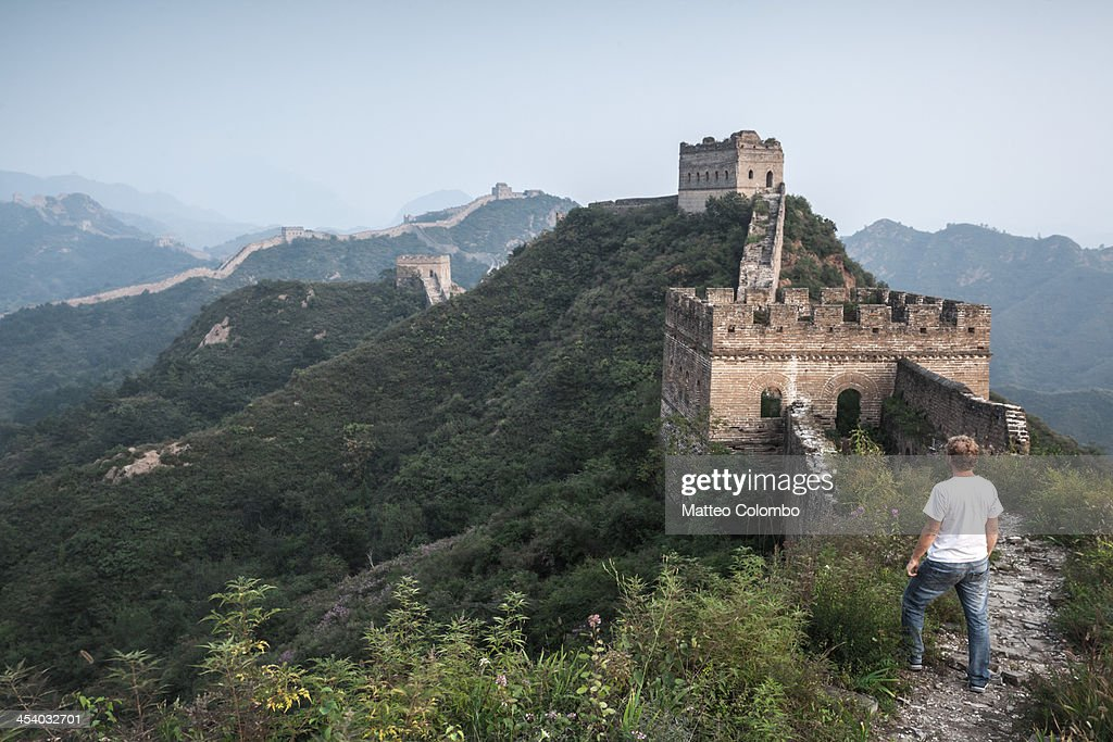 Tourist looking at the Great Wall of China