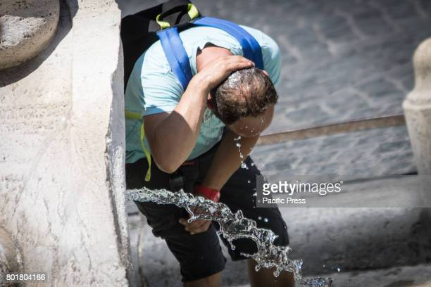 Tourist looking for refreshment in the eternal cities where temperatures touch the 40 degrees In the Capital is the high risk of drought the tiber in...