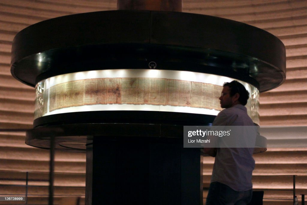 A tourist looks at a replica of the Dead Sea Scrolls on display, inside the Shrine of the Book building at the Israel Museum on September, 26, 2011. in Jerusalem, Israel. For the first time some of the Dead Sea Scrolls are available online thanks to a partnership between Google and Israel's national museum.