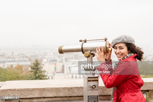 Tourist looks at cityscape with viewfinder, Paris. : Stock Photo